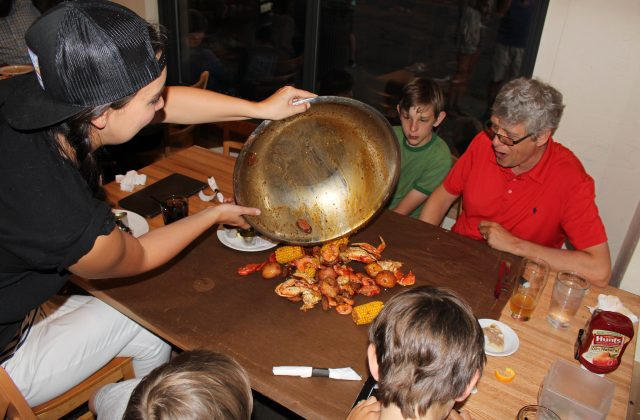 family enjoying cajun boil at steamworks restaurant durango